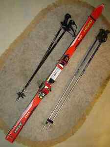 Down hill skis & poles & boots