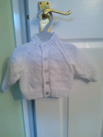 New, hand knitted baby cardigan