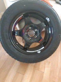 Brand new tyre and wheel