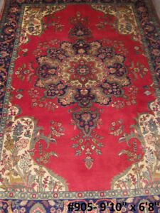 Persian Tabriz Handwoven wool area rug.