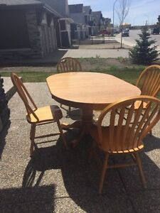 Dining set- Oak pedestal table with 4 chairs