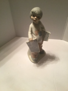 Tengra Boy Selling Newspapers Figurine 8.75 inches tall