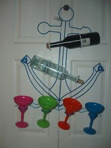Unique anchor shape glass and (wine) bottle holder