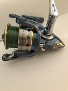 Pflueger President Spin Reel. (Gold, Silver, and Blue)