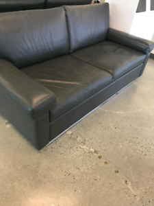 Modern leather loveseat in excellent condition