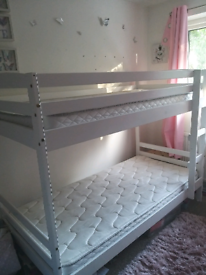 White wooden bunk beds with silent night mattresses