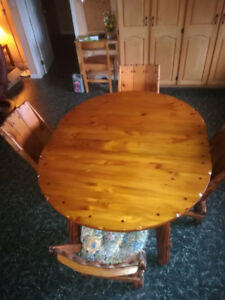 Solid wood table, 4 chairs, extendable leaf, cushions included