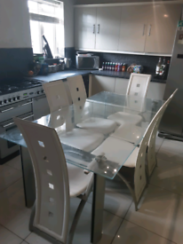 Glass table and x6 chairs
