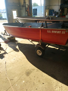 14ft Aluminum boat w/ trailer and 9.9 Merc