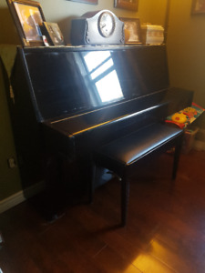 Piano, bench and books. Located in Grand Bay $250 OBO