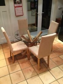 Oak and glass dining table with four chairs