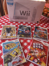 Nintendo wii console boxed and kids games can deliver
