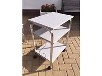 GREY SIDE TABLE WITH 2 SHELVES ONE 4 WHEELS