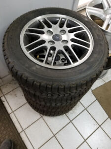 Brand new 185 65 15 Winters on OEM Ford Focus rims 4x108