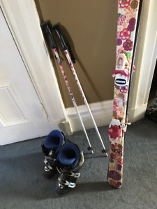 Skis, poles and boots, used but in great condition!