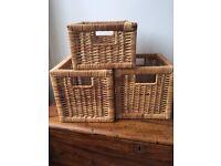 Three small wicker baskets