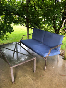 Outdoor Glass Coffee Table with Matching Cushioned Love Seat