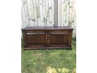Solid oak and very heavy oak tv unit in very good condition