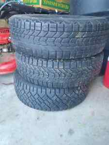 3 winter tires, 2 are 185/70r14 one tire 195/60r14