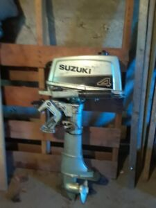 4 HP Suzuki outboard and 15 ft. Explorer canoe