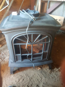 Nat gas fired cast iron stove fireplace.