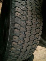 TWO  LT 275/70/17 WRANGLER ATS.  60-65% THREAD. $60
