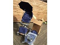 Excellent condition Stokke Xplory V4 Deep Blue-Carrycot, Parasol, Car Seat Adaptors & Cup Holder