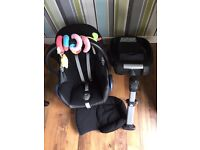 Maxi cosi car seat with newborn insert, base and toy