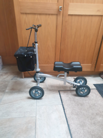 Knee scooter walker adjustable, folding,brakes pneumatic wheels basket