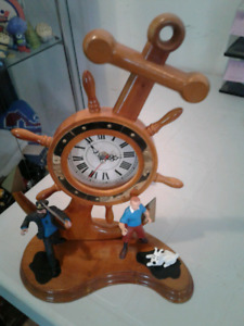 Horloge et figurines de la collection tintin
