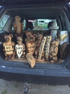 Chainsawed carvings: Eagles, owls, and bears for all ocassions