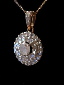 Ladies 10k yellow gold and diamond pendant.