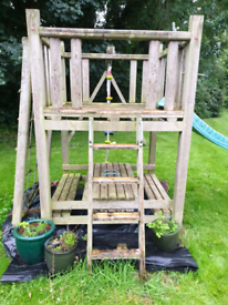Outdoor play frame with swings and sandpit