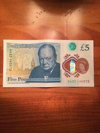AA plastic £5 note