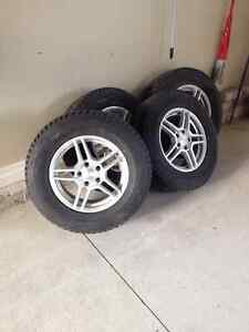 snow tires 225/70R16 w/alum rims