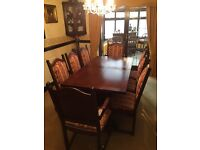 Old charm dark oak extending dinning table and 8 chairs