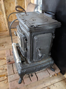 Wood stove with chimney pipe