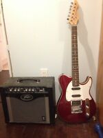Red peavy generation guitar with peavy amp