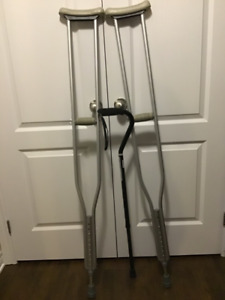 Pair of adjustable crutches and a metal cane