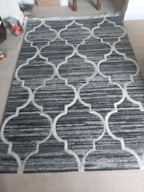 Black, grey and white rug.