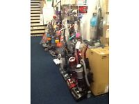Hoovers and vacuum cleaners upright and cylinders