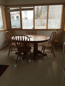 Oak Table with leaf and 8 chairs