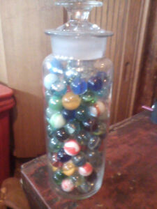 Old Apothecary jar with marbles