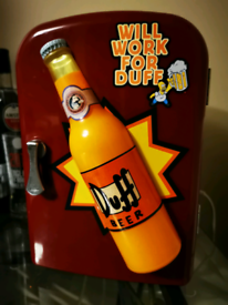 Small Simpson's fridge with glowing bottle at front