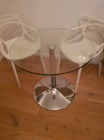 Glass and metal round dining table