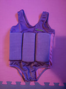 Swim suit with attatched floats