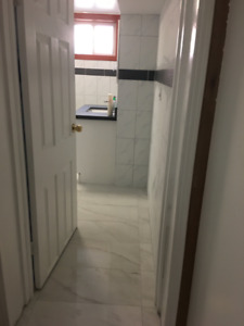 Renovated Basement Apartment, Located At Kennedy/Lawrence.