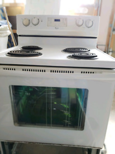 White Whirlpool stove and white Broan rangehood
