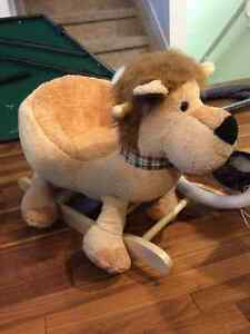 Plush rocking lion
