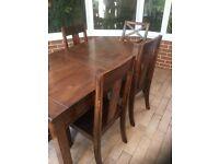 Dark stained pine dining table w 6 chairs. Mechanism to enlarge to 8.